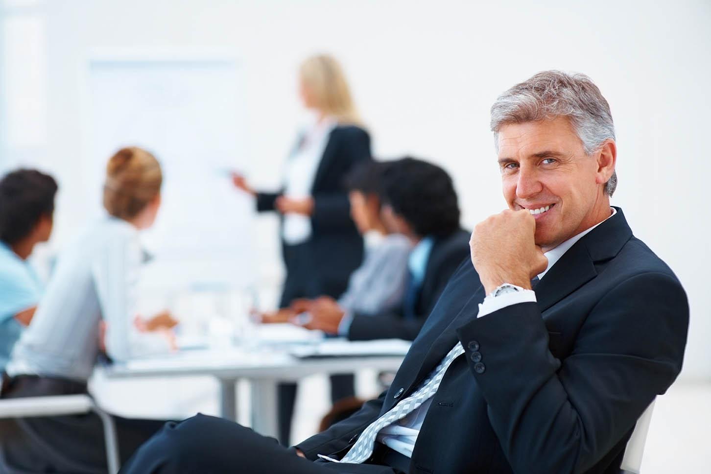Professional English courses - Business man studying English