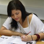 Cambridge English exam - girl student studying English full time